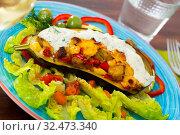 Купить «Eggplant stuffed with vegetables and baked with cheese, served at plate», фото № 32473340, снято 15 декабря 2019 г. (c) Яков Филимонов / Фотобанк Лори