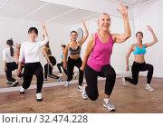 Купить «Ordinary active females exercising dance moves», фото № 32474228, снято 21 сентября 2019 г. (c) Яков Филимонов / Фотобанк Лори
