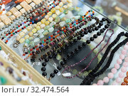 Купить «Necklaces from precious stones in jewelry store», фото № 32474564, снято 6 декабря 2019 г. (c) Яков Филимонов / Фотобанк Лори