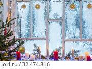 Купить «Christmas decorations on old wooden window», фото № 32474816, снято 9 января 2019 г. (c) Майя Крученкова / Фотобанк Лори