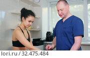 Купить «Chiropractic treatment - the doctor testing out the reaction on Wartenberg Wheel on young woman's hand», видеоролик № 32475484, снято 20 февраля 2020 г. (c) Константин Шишкин / Фотобанк Лори