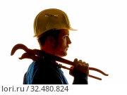 Купить «Ein Arbeiter in einem Gewerbebetrieb ( Handwerker ) mit Werkzeug in der Hand», фото № 32480824, снято 8 июля 2020 г. (c) age Fotostock / Фотобанк Лори