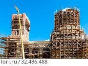 Construction of new orthodox church of Saint Spyridon (St Spiridon) Bishop of Trimythous in Koptevo district of Moscow on sunny summer day. Стоковое фото, фотограф Zoonar.com/Valery Voennyy / easy Fotostock / Фотобанк Лори