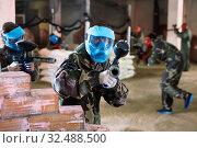 Купить «Portrait of blue team player who is aiming in opponents on paintball field.», фото № 32488500, снято 10 июля 2017 г. (c) Яков Филимонов / Фотобанк Лори