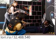 Купить «group of adult people with laser guns having fun», фото № 32488540, снято 23 января 2019 г. (c) Яков Филимонов / Фотобанк Лори