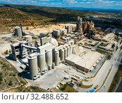 Купить «Cement plant in Bunol, Spain», фото № 32488652, снято 24 апреля 2019 г. (c) Яков Филимонов / Фотобанк Лори