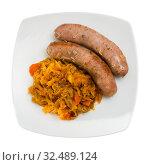 Top view of sausages with braised cabbage. Стоковое фото, фотограф Яков Филимонов / Фотобанк Лори