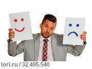 Ein Manager oder Unternehmer kann sich nicht entscheiden ob er weinen oder lachen soll. Стоковое фото, фотограф Zoonar.com/Erwin Wodicka / age Fotostock / Фотобанк Лори