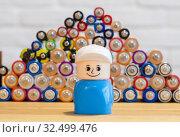 Купить «Детская игрушка на фоне старых батареек», фото № 32499476, снято 26 ноября 2019 г. (c) Яковлев Сергей / Фотобанк Лори