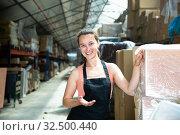 Купить «Female in apron standing near shelves with cardboard boxes for packaging», фото № 32500440, снято 10 декабря 2019 г. (c) Яков Филимонов / Фотобанк Лори