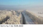 Купить «Aerial video view from drone of a Sunrise over snowy winter road. Siberia, Russia», видеоролик № 32508660, снято 5 ноября 2019 г. (c) Serg Zastavkin / Фотобанк Лори