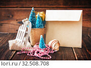 Купить «Artificial little Christmas treees in biodegradable peat moss, craft envelope, small sledge and wooden shavings», фото № 32508708, снято 26 ноября 2019 г. (c) Papoyan Irina / Фотобанк Лори