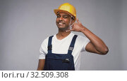 Купить «happy worker or builder making phone call gesture», видеоролик № 32509308, снято 26 ноября 2019 г. (c) Syda Productions / Фотобанк Лори