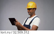 Купить «happy indian builder in helmet with tablet pc», видеоролик № 32509312, снято 26 ноября 2019 г. (c) Syda Productions / Фотобанк Лори