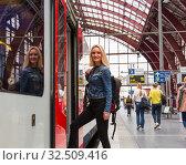 Купить «Female tourist enters the train on railway station», фото № 32509416, снято 10 июля 2019 г. (c) Tryapitsyn Sergiy / Фотобанк Лори