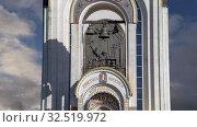 Купить «Church of St George on Poklonnaya hill (on the background of moving clouds), Moscow, Russia. Christ is Risen, Eternal memory of those who died in the great Patriotic war—inscription in Russian», видеоролик № 32519972, снято 27 ноября 2019 г. (c) Владимир Журавлев / Фотобанк Лори