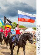 Купить «Russia, Samara, July 2019: Solemn entry of a group of horse racing with flags in the meadow of the festival.», фото № 32526112, снято 28 июля 2019 г. (c) Акиньшин Владимир / Фотобанк Лори