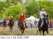 Купить «Russia, Samara, July 2019: Cossacks perform tricks on a galloping horse.», фото № 32526144, снято 28 июля 2019 г. (c) Акиньшин Владимир / Фотобанк Лори