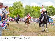 Купить «Russia, Samara, July 2019: Cossacks perform tricks on a galloping horse.», фото № 32526148, снято 28 июля 2019 г. (c) Акиньшин Владимир / Фотобанк Лори