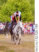 Купить «Russia, Samara, July 2019: Cossacks perform tricks on a galloping horse.», фото № 32526188, снято 28 июля 2019 г. (c) Акиньшин Владимир / Фотобанк Лори