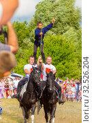 Купить «Russia, Samara, July 2019: Cossacks perform tricks on a galloping horse.», фото № 32526204, снято 28 июля 2019 г. (c) Акиньшин Владимир / Фотобанк Лори