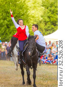 Купить «Russia, Samara, July 2019: Cossacks perform tricks on a galloping horse.», фото № 32526208, снято 28 июля 2019 г. (c) Акиньшин Владимир / Фотобанк Лори