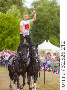 Купить «Russia, Samara, July 2019: Cossacks perform tricks on a galloping horse.», фото № 32526212, снято 28 июля 2019 г. (c) Акиньшин Владимир / Фотобанк Лори
