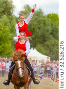 Купить «Russia, Samara, July 2018: Demonstration of a Cossack girl on a horse for guests and spectators of the festival.», фото № 32526216, снято 28 июля 2019 г. (c) Акиньшин Владимир / Фотобанк Лори