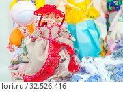 Купить «Russia, Samara, July 2019: sale of handmade souvenirs. Fair of folk art. A bright doll among amulets.», фото № 32526416, снято 28 июля 2019 г. (c) Акиньшин Владимир / Фотобанк Лори