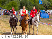 Купить «Russia, Samara, July 2019: Cossacks perform tricks on a galloping horse.», фото № 32526480, снято 28 июля 2019 г. (c) Акиньшин Владимир / Фотобанк Лори