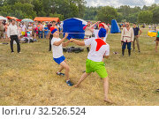 Купить «Russia, Samara, July 2019: an ethno-historical holiday with a reconstruction of the battle of Timur and Tokhtamysh in 1391. Battle of Stenos. Competition of men from wall to wall. Fist fights.», фото № 32526524, снято 28 июля 2019 г. (c) Акиньшин Владимир / Фотобанк Лори
