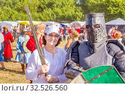Купить «Russia, Samara, July 2019: an ethno-historical holiday with a reconstruction of the battle of Timur and Tokhtamysh in 1391. Joint photo with the participant of the festival. Warrior in the armor.», фото № 32526560, снято 28 июля 2019 г. (c) Акиньшин Владимир / Фотобанк Лори