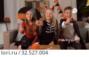 Купить «kids in halloween costumes having fun at home», видеоролик № 32527004, снято 14 ноября 2019 г. (c) Syda Productions / Фотобанк Лори