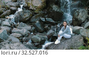 Woman on nature near waterfall. Стоковое видео, видеограф Илья Шаматура / Фотобанк Лори