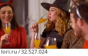 Купить «happy friends in halloween costumes at home party», видеоролик № 32527024, снято 18 ноября 2019 г. (c) Syda Productions / Фотобанк Лори