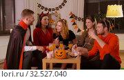 Купить «happy friends in halloween costumes at home party», видеоролик № 32527040, снято 18 ноября 2019 г. (c) Syda Productions / Фотобанк Лори