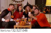 Купить «happy friends in halloween costumes taking selfie», видеоролик № 32527048, снято 18 ноября 2019 г. (c) Syda Productions / Фотобанк Лори