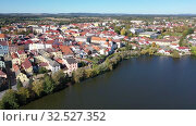 Купить «Aerial view of old town of Jindrichuv Hradec on Nezarka river with medieval Castle on fall day, Czech Republic», видеоролик № 32527352, снято 12 октября 2019 г. (c) Яков Филимонов / Фотобанк Лори