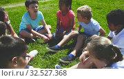 Portrait of children on the summer green lawn. Стоковое видео, видеограф Яков Филимонов / Фотобанк Лори