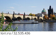 Купить «View of Charles bridge in autumn sunny day. Prague. Czech republic», видеоролик № 32535436, снято 13 октября 2019 г. (c) Яков Филимонов / Фотобанк Лори