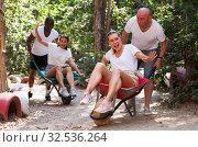 Friends rolling each other on wheelbarrows. Стоковое фото, фотограф Яков Филимонов / Фотобанк Лори