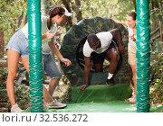People passing obstacles at adventure park. Стоковое фото, фотограф Яков Филимонов / Фотобанк Лори