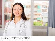 Купить «Young woman doctor in white uniform standing in clinic's office», фото № 32538388, снято 1 мая 2018 г. (c) Яков Филимонов / Фотобанк Лори