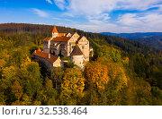 Купить «Medieval castle of Pernstein on a hill in the forest. South Moravian region. Czech Republic», фото № 32538464, снято 15 октября 2019 г. (c) Яков Филимонов / Фотобанк Лори