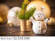 Christmas golden decorations and snowman on dark wooden backgrou. Стоковое фото, фотограф Майя Крученкова / Фотобанк Лори