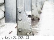 Купить «Gray metal structures connected with bolts», фото № 32553432, снято 9 ноября 2019 г. (c) EugeneSergeev / Фотобанк Лори