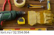 Купить «different work tools on wooden boards», видеоролик № 32554064, снято 28 ноября 2019 г. (c) Syda Productions / Фотобанк Лори