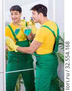 Купить «Professional cleaning contractor working at home», фото № 32554168, снято 5 апреля 2018 г. (c) Elnur / Фотобанк Лори