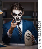 Купить «The businessman with scary face mask working late in office», фото № 32554208, снято 9 ноября 2017 г. (c) Elnur / Фотобанк Лори