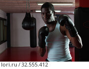 Купить «Potrait of african american boxer who is training in gym», фото № 32555412, снято 28 января 2019 г. (c) Яков Филимонов / Фотобанк Лори